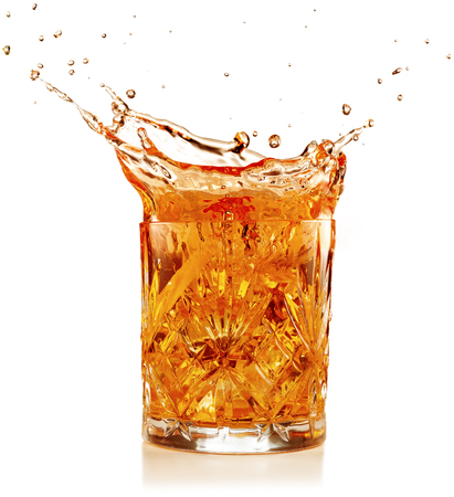 orange coktail splashing isolated on white Stock Photo
