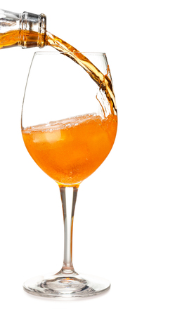 pour aperol in a spritz cocktail isolated on white