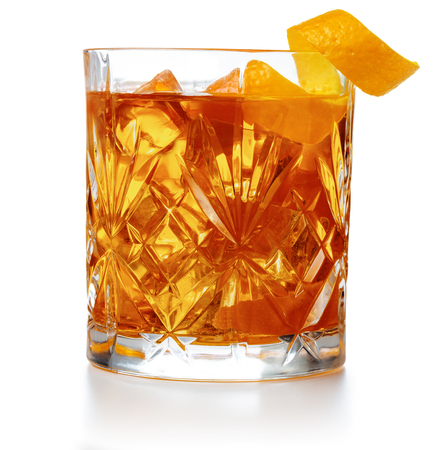old fashioned cocktail garnished with orange twist peel isolated Standard-Bild