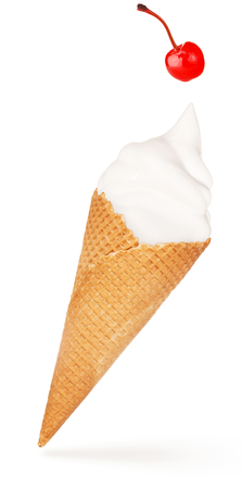 red cherry falling on a soft serve ice cream cone isolated
