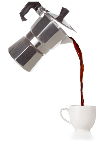 coffee poured from a flying moka into a cup isolated on white