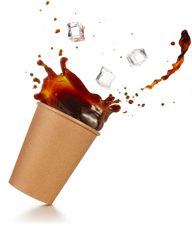 ice cubes falling into a splashing take-out coffee isolated on white