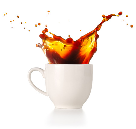 coffee spilling out of a cup isolated on white background