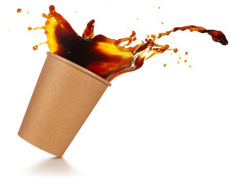 coffee splashing out of a take-out cup tilted on white background Stok Fotoğraf