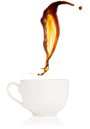 coffee splash flying above a cup isolated on white Banco de Imagens