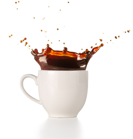 coffee splashing out of a cup isolated on white background Banco de Imagens