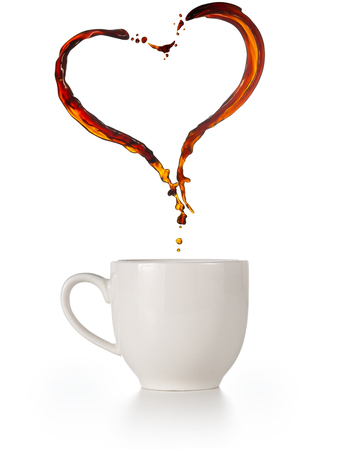 heart-shaped coffee splashes flying over a cup isolated on white Banco de Imagens