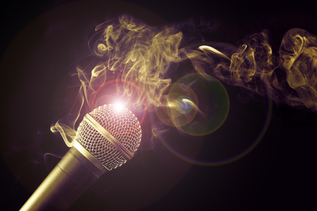 microphone and swirl of smoke on black background