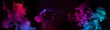 blue and purple swirls of smoke on black background Banco de Imagens