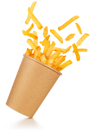 fries spilling out of a take-out paper cup tilted on white background 스톡 콘텐츠