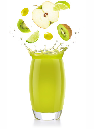mixed green fruit falling into a splashing juice glass isolated on white Banco de Imagens