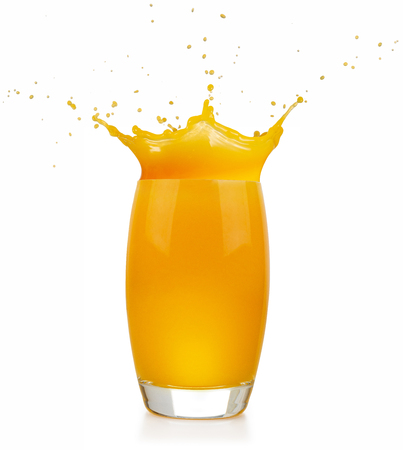 glass full of orange juice splashing on white background Banco de Imagens