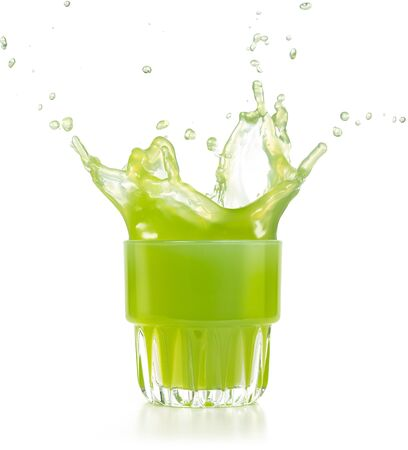 green juice exploding out of a glass isolated on white Banco de Imagens