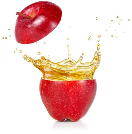 transparent juice squirting out of a red apple isolated on white