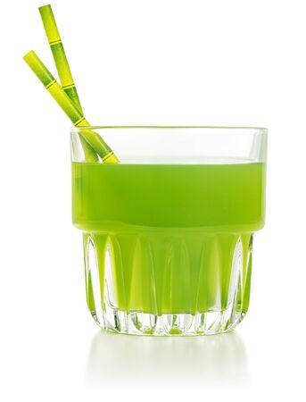 green beverage glass with bamboo straws isolated on white background Banco de Imagens