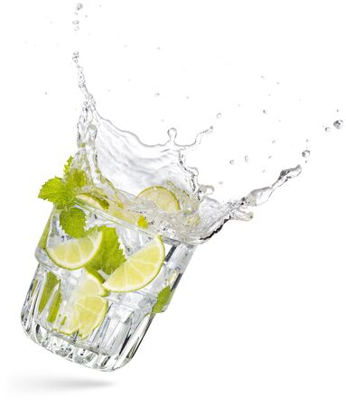 glass of flying and splashing mojito isolated on white