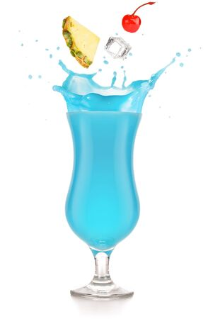 pineapple, cherry and ice falling into a splashing blue cocktail isolated