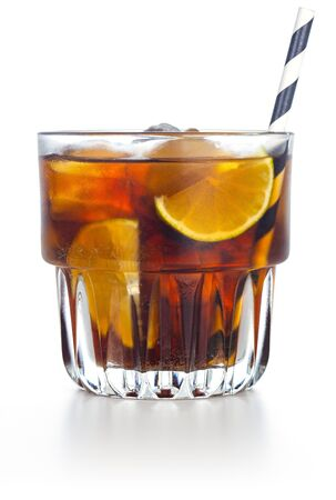 close up of whiskey and cola drink isolated on white background