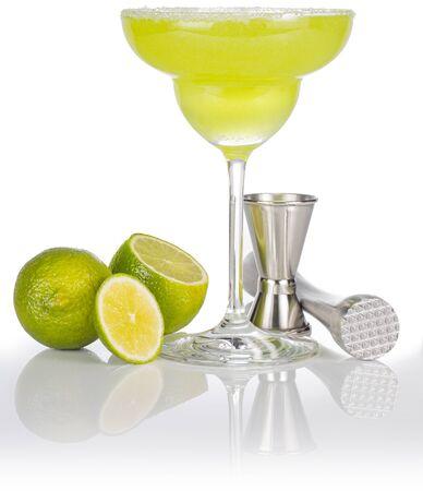 glass of margarita, lime, jigger and pestle isolated on white Standard-Bild