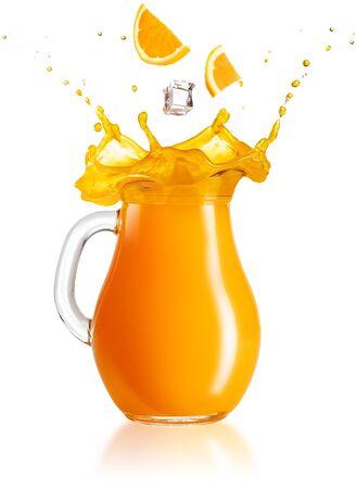 slices of orange and ice cube falling into a splashing jug on white background Standard-Bild