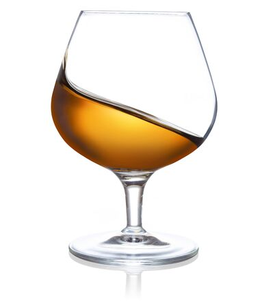 wave of brandy in a glass isolated on white background