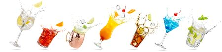 collection of tilted glasses with splashing cocktails isolated on white 免版税图像