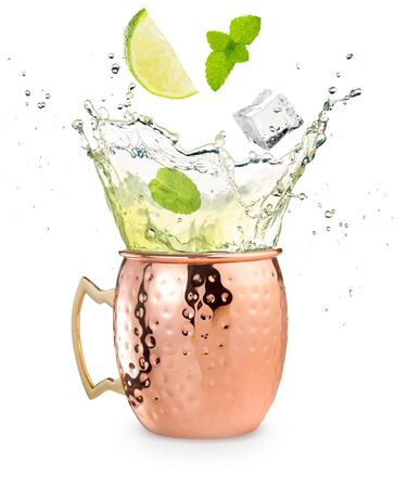 lime, mint and ice cube falling into a splashing moscow mule cocktail isolated on white