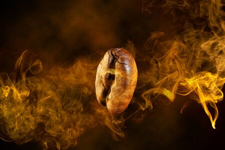 close up of a coffee bean wrapped in orange smoke swirl flying on dark background