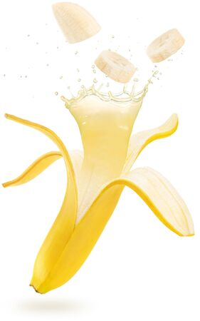juice splashing out of an open and sliced banana floating isolated on white background