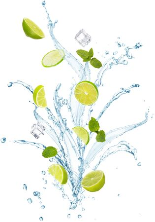 water splash with mint leaves, slices of lime and ice cubes isolated on white background 免版税图像