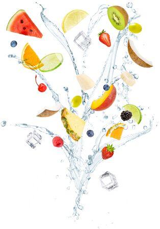 slices of fresh fruit flying among water vertical splashes isolated on white background