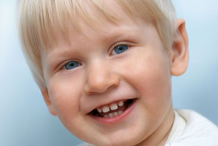 Portrait of smiling little child             photo