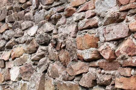 dilapidated wall: Old stone wall, a horizontal picture