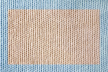Knitted fabric - macro of a woolen texture Stock Photo