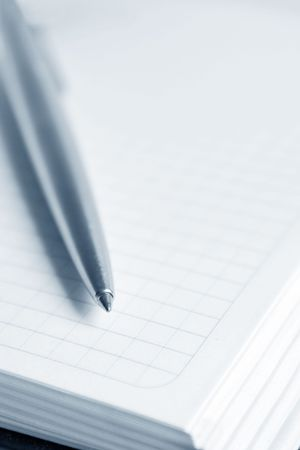 Open notebook with a pen Stock Photo - 5585673