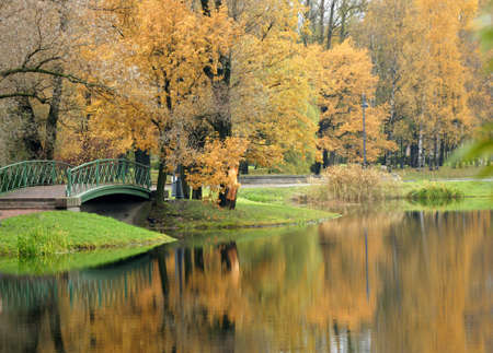 reverberation: Bridge in autumn park, a horizontal picture Stock Photo