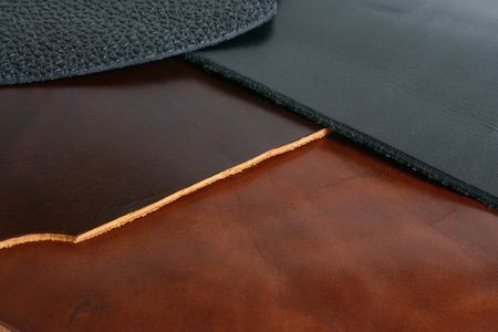 Natural black and brown leathers background closeup Stock Photo - 6062355