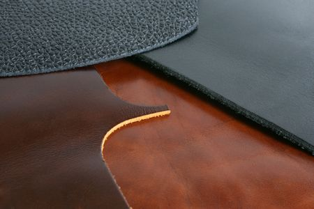 Natural black and brown leathers background closeup Stock Photo - 6087200