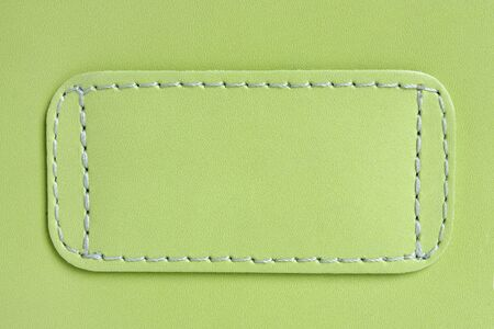 Natural green leather background closeup photo