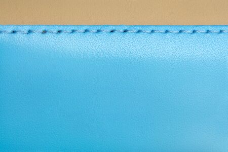 Natural blue and brown leather background closeup photo