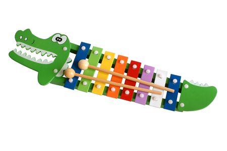 xilofono: Xil�fono colorido de juguete aislado en el fondo blanco