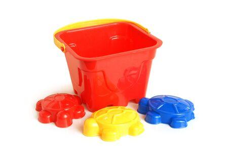 Sand-box toys on white background photo