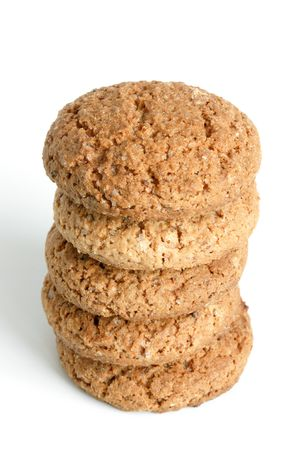 Stack of oatmeal cookies on the white background photo