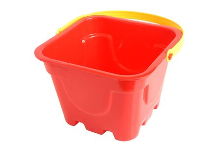 Plastic red bucket toy isolated on the white background photo