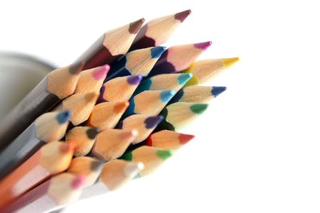 Colored pencils isolated on the white background photo