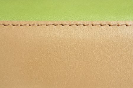 Natural green and brown leather background closeup photo