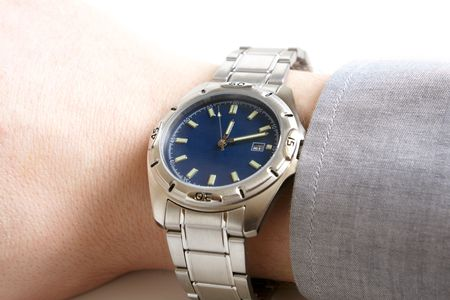 dialplate: Closeup of businessmans hand with wristwatch