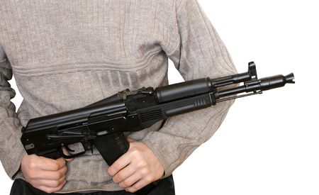 Man with AK-105 machine gun isolated on the white background photo