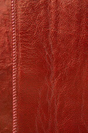 Natural red leather background closeup photo