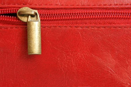 Red leather with zipper background closeup photo